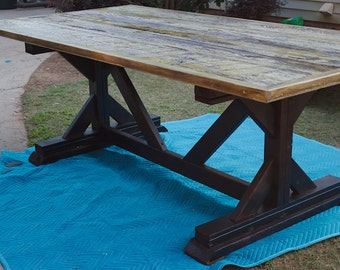 Trestle base barn wood table with marine finish in rye grass green paint with matching bench