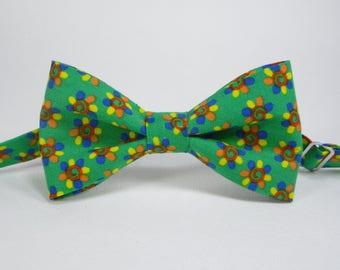Flower on green bow tie green flower free style floral bow tie adult bow tie toddler bow tie boys green bow tie newborn bowtie rustic bowtie