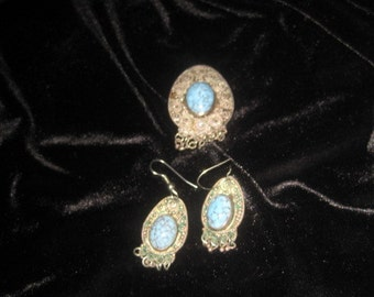 Vintage sterling silver brooch and earrings set; turquoise centers. Marked as sterling.