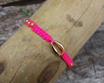Adjustable strap and neon pink brass cowrie