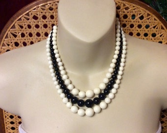 Vintage 1950's triple strand black and white beads necklace.