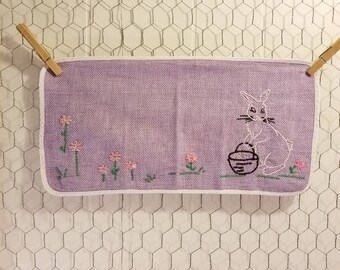 Vintage embroidery Easter bunny white lavender pink flowers green grass black basket 16×8 inches
