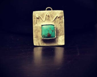 Crown pendant with turquoise gem stone