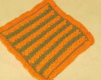 Crochet wash cloth, orange and green