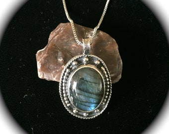 Spectacular Labradorite blue/ green flash pendant set in .925 sterling silver by Giovannipitar.com