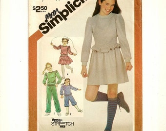 "A Miniskirt, Knickers, Pants, and Long Sleeve Top Sewing Pattern for Girls: Size Large (12-14), Breast 30"" - 32"" • Simplicity 5771"