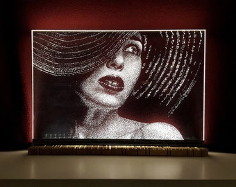 The matter of beauty. Lamp, luminous sculpture with a woman's portrait. Hand engraving on plexiglass