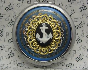 Miroir compact ancres Aweigh sur fond bleu est livré avec pochette