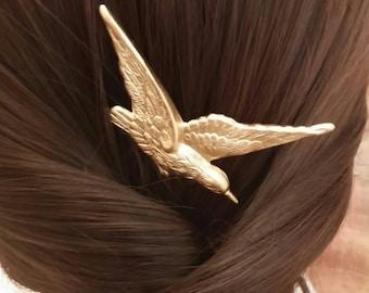 Comb with brass bird