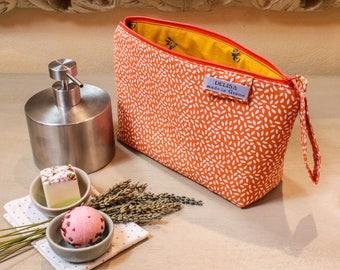 Orange zipper pouch. Cosmetic bag. Medium sized makeup bag. Toiletry bag. Travel cosmetic case. Orange zipper pouch.