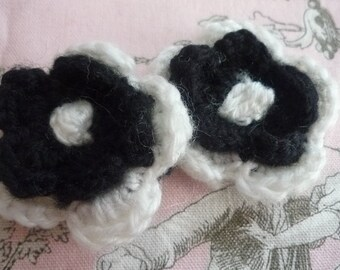 2 crocheted wool black and white flowers
