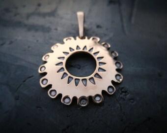 Bronze Sun symbol pendant
