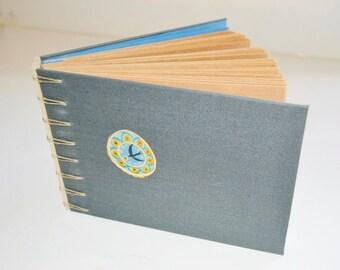 Blank book. Binding hand.