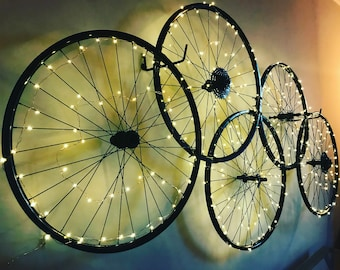 bike wheel wall handing with twinkle lights