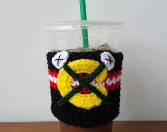 Blackhawks inspired crocheted coffee cozy. Drink cozy