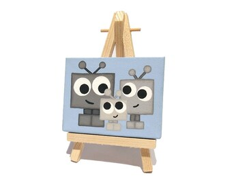 Cute Robot Family Mini Painting - small original art with a grey cartoon mother, father and baby robot, blue miniature canvas with easel