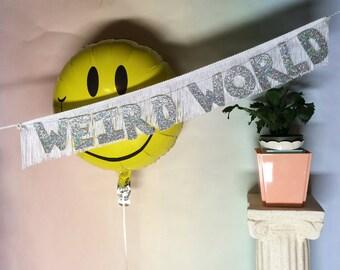 Weird World Glittering Fringe Banner | fringe wall hanging, party banner, home decor, dorm decor, funny banner, letter garland, weird times