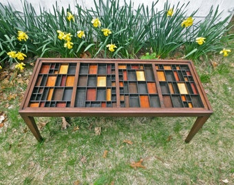 Custom handmade coffee table cherry wood with a collection table top that is made from printers type boxes or letterpress type cases.