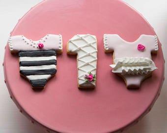 Black and pink onesie cookies