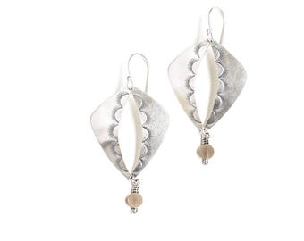 """Distinctive silver and brass earrings inspired by Ancient Egypt embellished with sunburst motifs around the focal cutout - """"Khepri Earrings"""""""