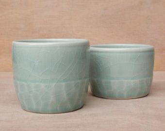 Set of two porcelain tumblers with facets and celadon glaze