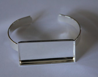 5 x Silver plated solid bangles with rectangle bezel tray