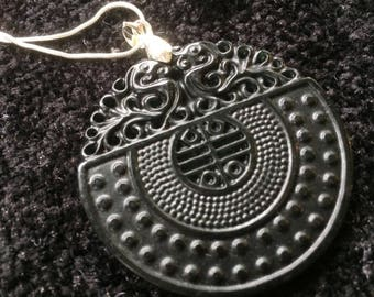 Black agate stone circular embossed pendant on silver tone chain