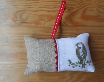 White and a linen cushion embroidered bird