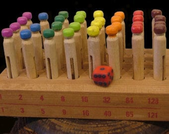 TRADE; Math Concept game appropriate for kids from 4 months to about 10 years with many game uses for different ages.