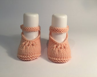 Hand knitted baby booties.