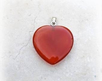 Carnelian (gemstone) heart pendant.