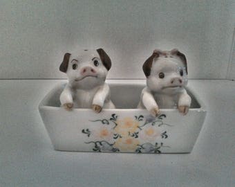 Pigs in a trough salt and pepper shakers with butter dish