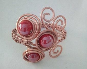 Aluminium braided bracelet with red stones