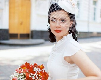 Wedding hat-veil in retro style with silk flowers