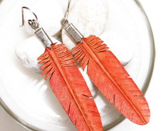 small coral leather feather earrings