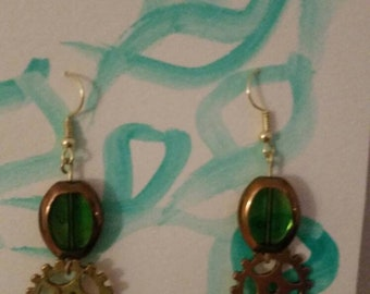 Green and gold beaded gear earrings