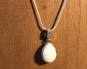 Milky White Stone Pendant with Rhinestone Accents on a Silver Chain