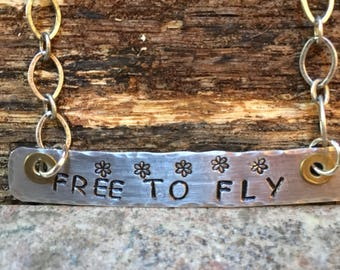 hand stamped and cut aluminum with hand stamped FREE TO FLY