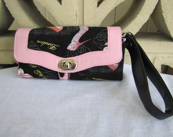 Black wallet with pink shoes