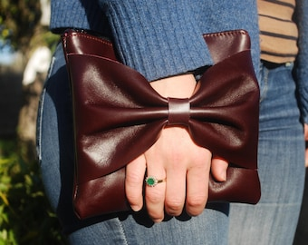 Made and plum leather wallet hand