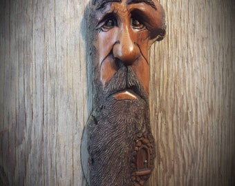 Woodcarving of a wood spirit by Murray Watson tree spirit Cottonwood bark carving ooak driftwood art hand carved face wood spirit.