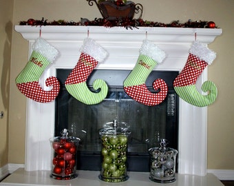 Whimsical red and green personalized Christmas stocking with curly elf toe