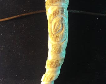 Double Spiral snake pendant on two planes.