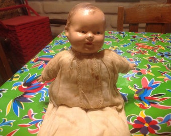 Vintage very old celluloid and cloth doll
