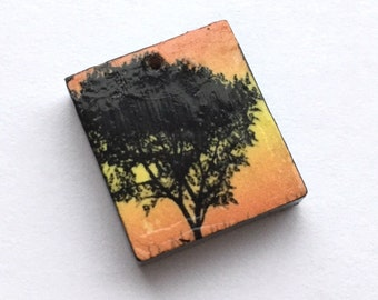 Orange and yellow tree charm, patterned sunset wooden scrabble tile painted black handmade jewellery supplies jewelry components crafting