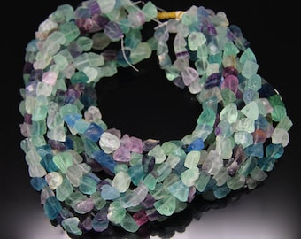 1strand - natural fluorite matt rough tumble sized about 10 by 13mm