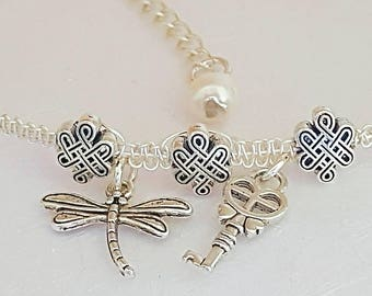 Macrame wire bracelet with dragonfly and key charms