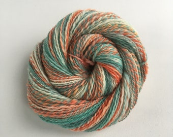 Hand Dyed and Spun Yarn, Southdown fiber, Aqua and Oranges.