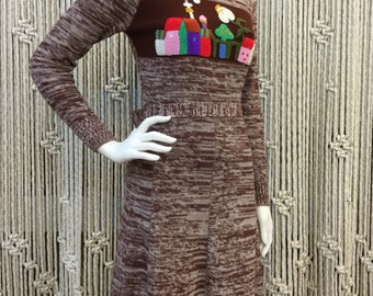 Precious 1970's Arpeja Mother Nature knit dress with crewel embroiderery of a town scene