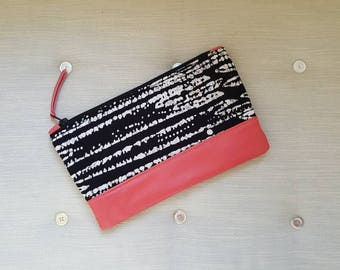 Recycled pink leather and recycled black and white batik clutch